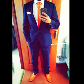 orangeandbluesuit.jpeg